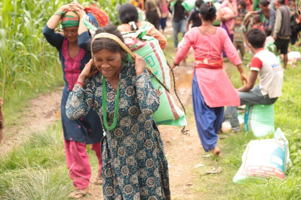IIAD food relief Nepal - woman carrying food